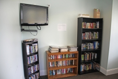 Media room and lounge with DVD library and flatscreen TV at Third and Main