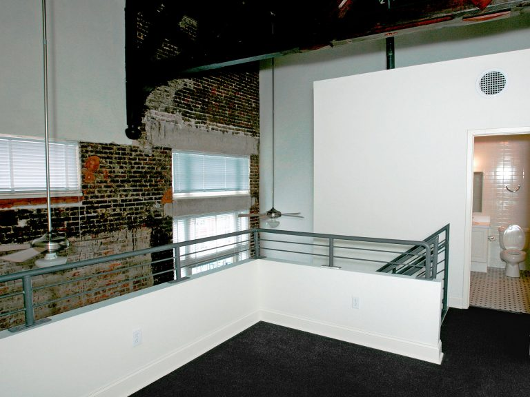 exposed brick walls with high ceilings