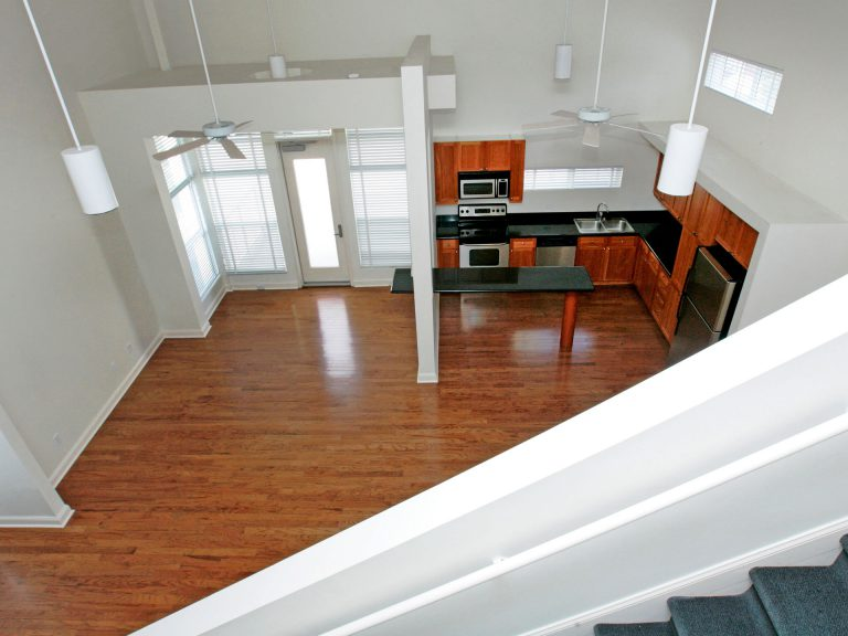 view from staircase looking down into open kitchen