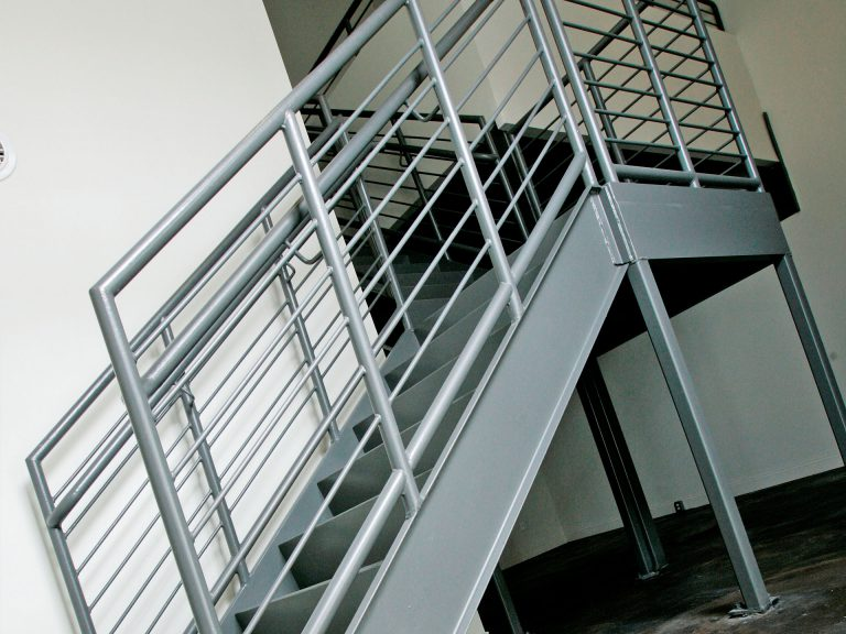 sturdy metal staircase leading to 2nd floor of loft apartment